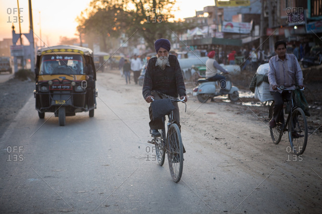 Amritsar, India - March 18, 2015: Bicyclists in Indian street
