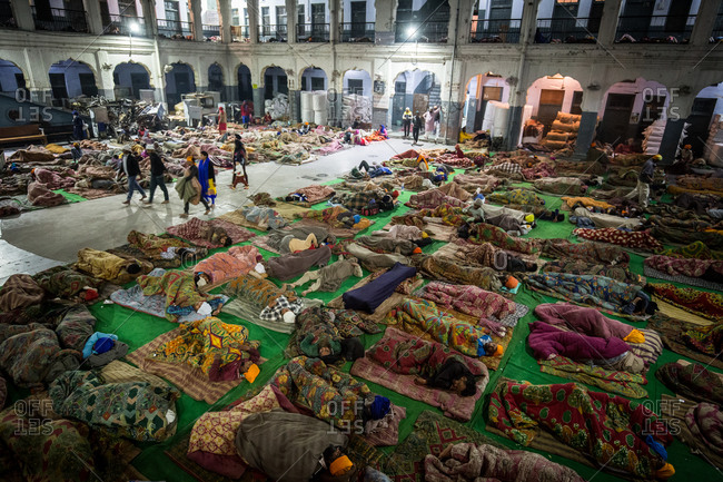 Amritsar, India - March 18, 2015: People sleeping in a temple