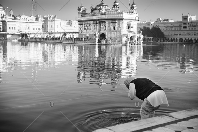 Man bathing by Sikh temple in India