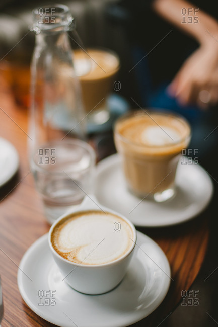 Three cups of coffee on a wooden table