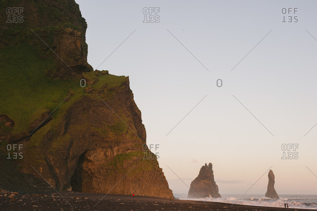 Vik beach and rock formations at sunset
