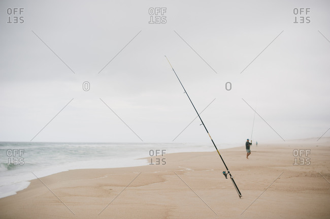 Fishing pole in sand at the beach