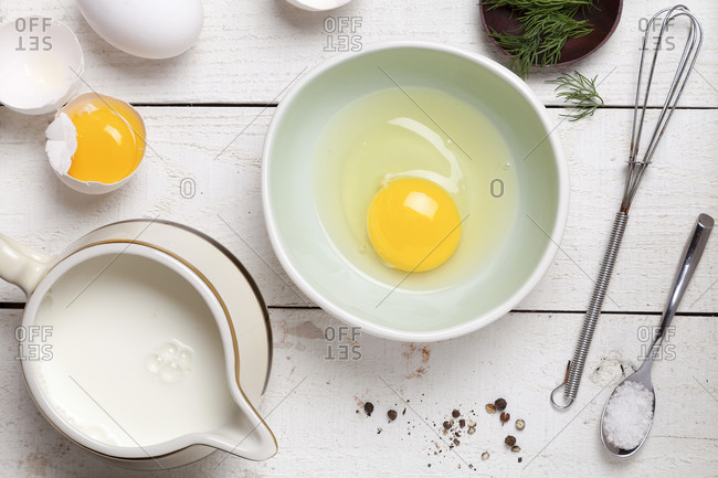 Cracked egg in bowl