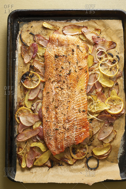 Roasted salmon on a pan with potatoes