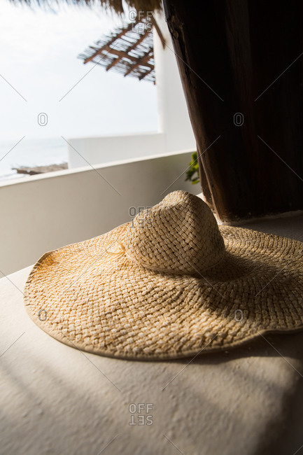Straw hat on wall at tropical resort