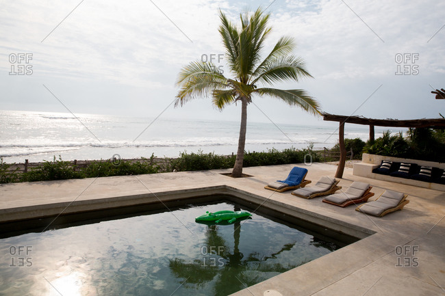 Oceanfront pool at tropical beach