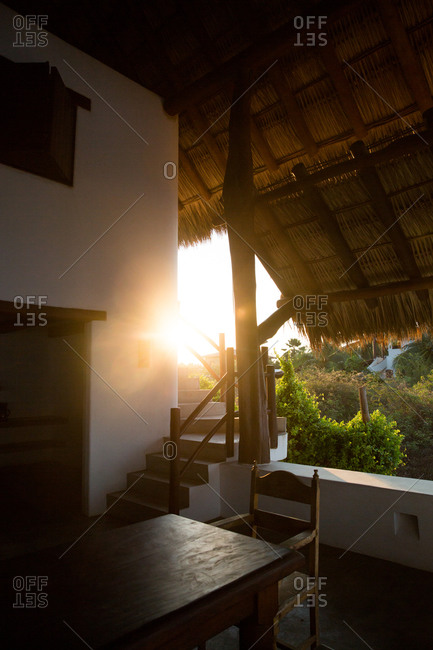 Sunset from an open air living room of tropical home