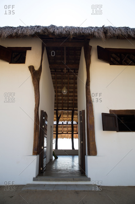Doorway of a thatched roof luxury vacation home