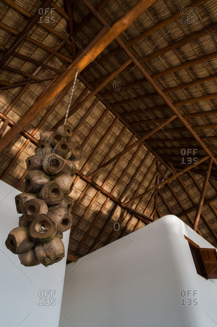 Upward view of a thatched roof building