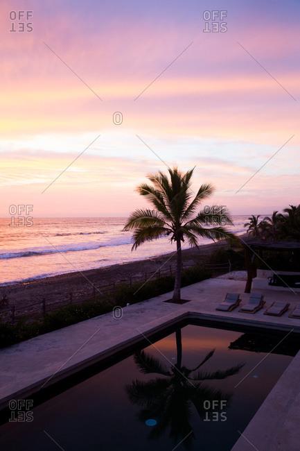 Oceanfront resort pool at dusk