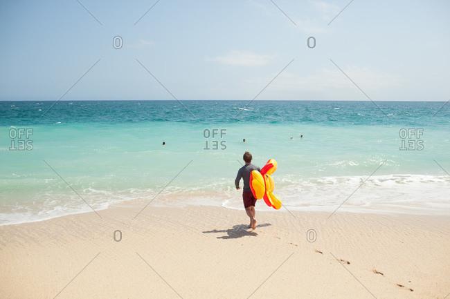 Man with surfboard on beach
