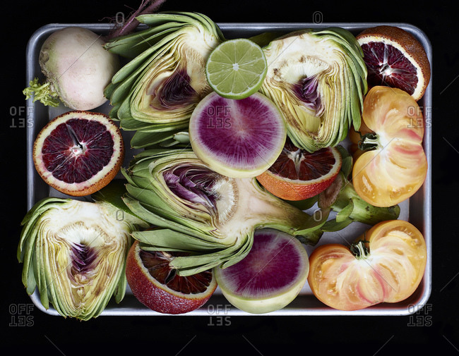 Close up of vegetables and fruits on metal tray