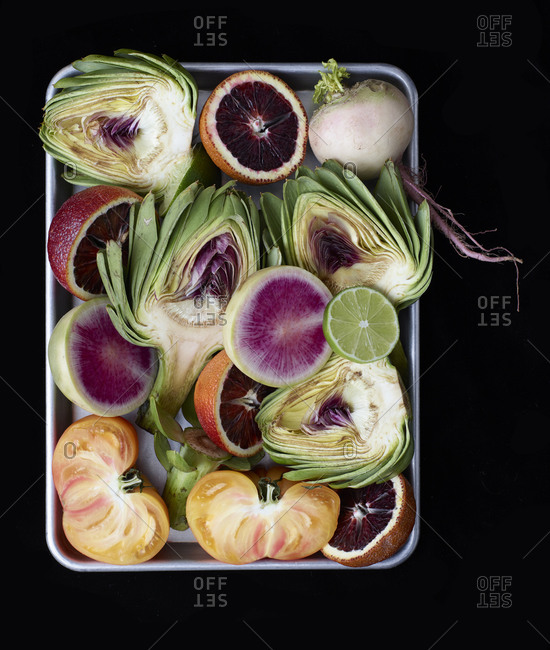 Close up of metal tray of fruits and vegetables