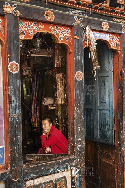 Bhutan - May 19, 2015: A young man in a tea shop in Thimbu, Bhutan