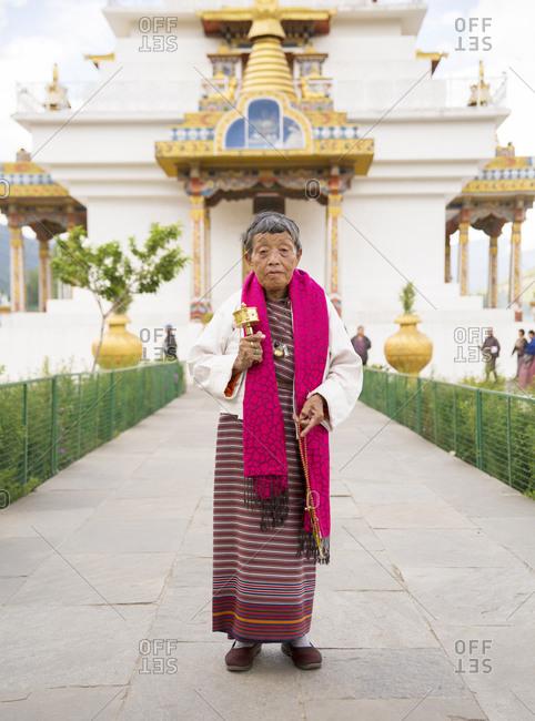 Bhutan - May 20, 2015: A Buddhist worshipper outside Memorial Chorten in Thimbu, Bhutan