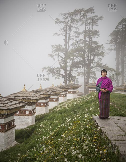 Bhutan - May 20, 2015: A woman wearing traditional Bhutanese clothing at Do Chula Pass, Bhutan