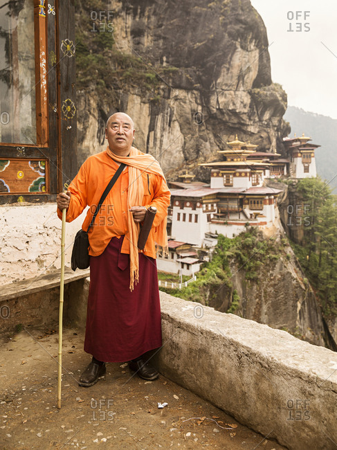 Bhutan - May 21, 2015: A Buddhist monk in front of the Tiger's Nest, Bhutan