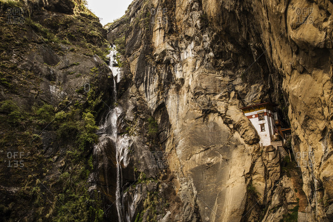 Stone house carved into the Cliffside near the Tiger's Nest Monastery, Bhutan