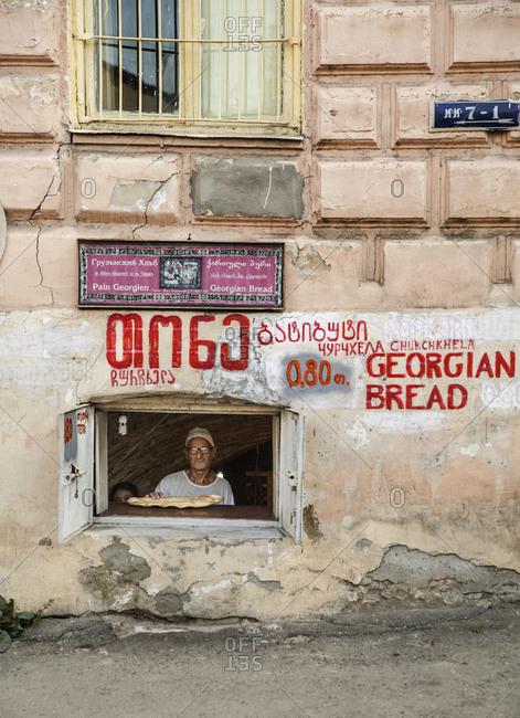 Tbilisi - October 20, 2015: A baker selling traditional Georgian bread in Tbilisi, Georgia
