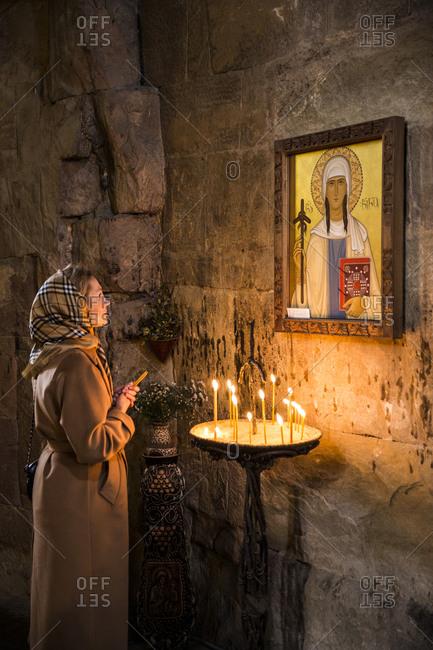 Tbilisi - September 28, 2015: A woman praying in an Orthodox church outside Tbilisi, Georgia