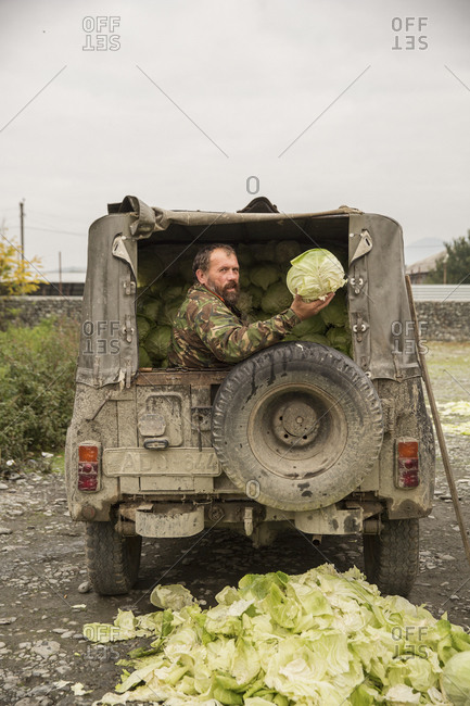 Tbilisi - October 22, 2015: Local farmer selling his produce at a market on the border between Georgia and Azerbaijan