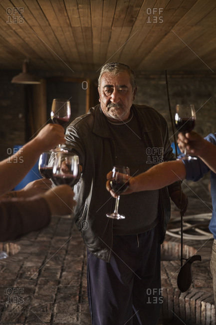 Tbilisi - October 23, 2015: Toasting and tasting wine in the cellar of wine producer Pheasants Tears in Signaghi, Georgia