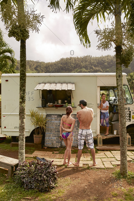 Hawaii - January 29, 2015: Couple buying food from a food truck on the North Shore of Oahu