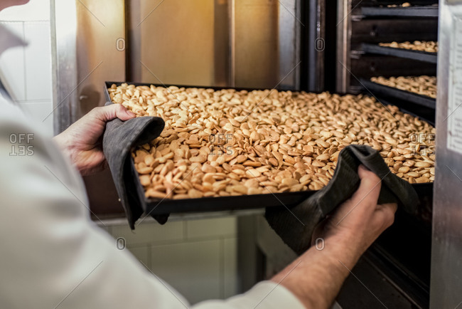 Roasted almonds on tray in confectionery shop