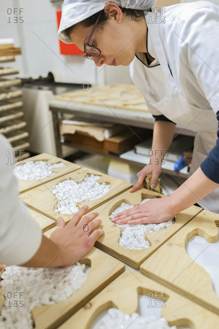 Putting dough into molds for traditional torrone