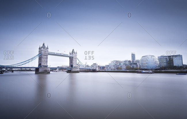 London skyline from river thames and Tower Bridge at twilight