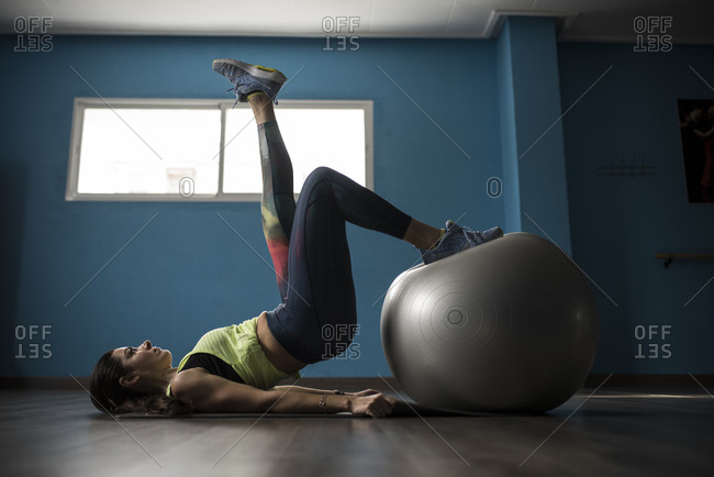 Woman exercises with fitness ball