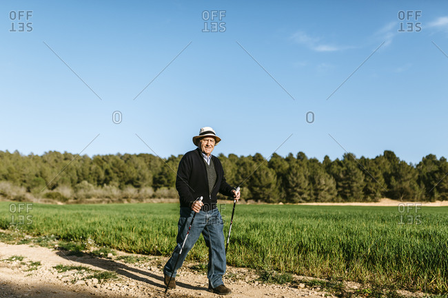 Man walking with sticks in the field