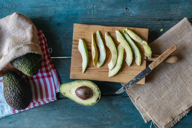 Sliced and whole avocado