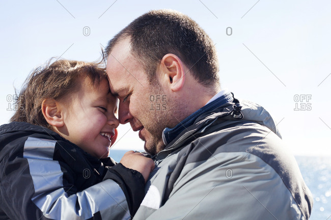 Happy father and his little son head to head