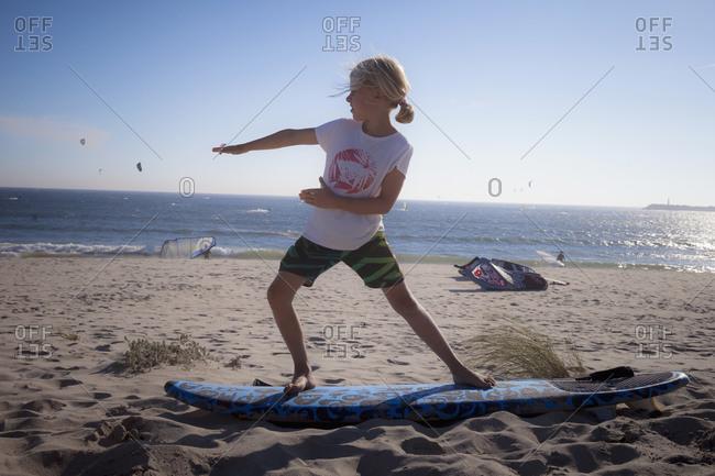 Little child playing on the beach, Viana do Castelo, Norte Region, Portugal