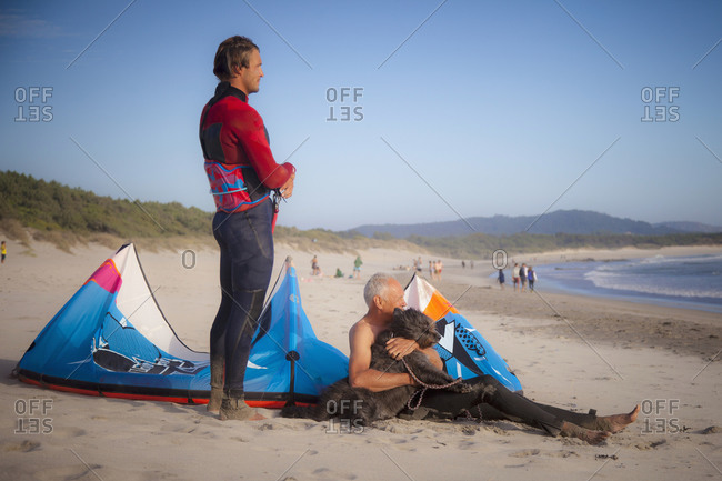Kite surfer with his father on the beach, Viana do Castelo, Norte Region, Portugal