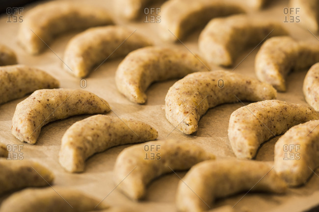 Close up of vanilla crescents in baking tray for baking, Munich, Bavaria, Germany