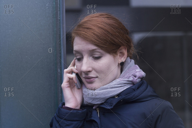 Young female engineer talking on a mobile phone near switchgear in an industrial plant, Freiburg im Breisgau, Baden-Wurttemberg, Germany