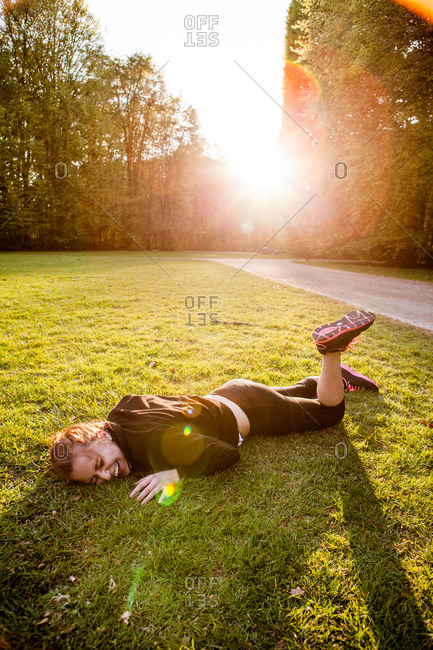 Young woman lying on grass at park