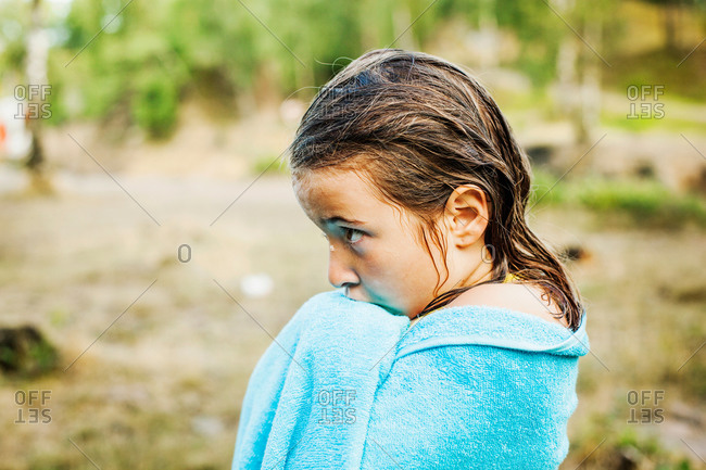Side view of wet girl wrapped in towel