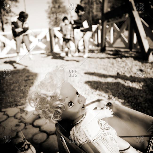 Abandoned doll on playground