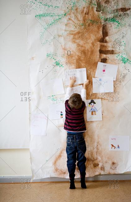 Boy placing a drawing