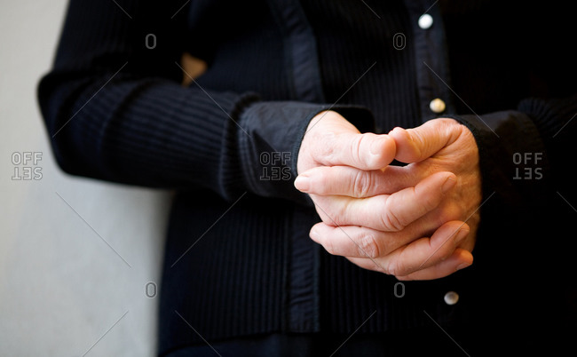 Person with closed hands