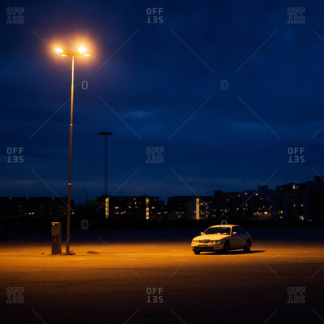 Car under streetlight