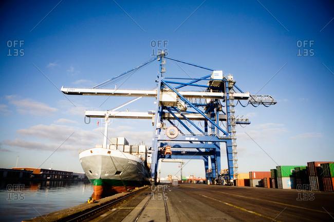 Charging crane loading transport ship