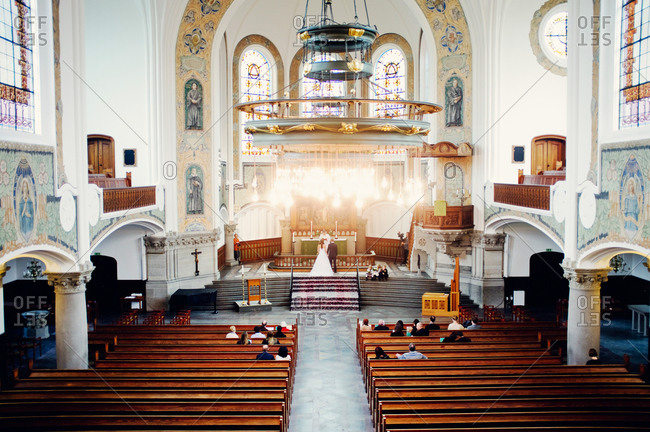 Interior of church with wedding ceremony in progress
