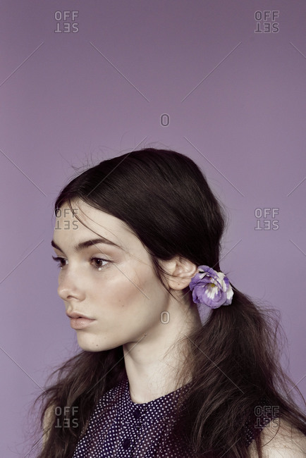 Portrait of a woman with a flower in her hair