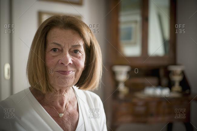 Older woman smiling indoors