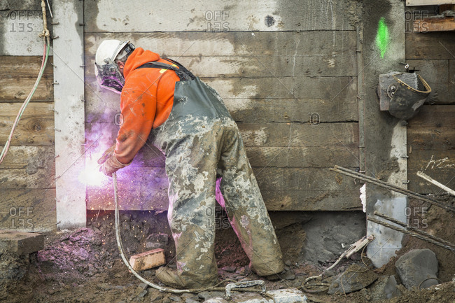 Worker welding at construction site