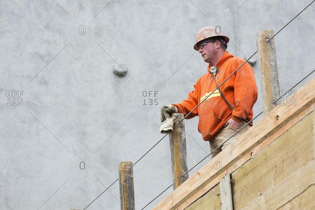 Worker standing at construction site